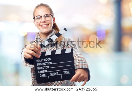 young cool woman with a clapperboard - stock photo