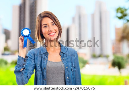 young cool woman with a medal - stock photo