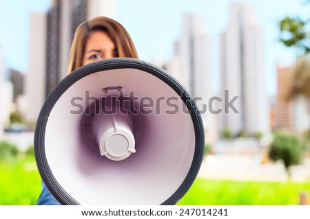 young cool woman with a megaphone - stock photo