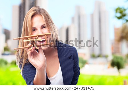 young cool woman with a wooden plane - stock photo