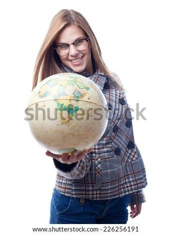 young cool woman with a world globe - stock photo