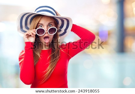 young cool woman with sunglasses and a hut. surprised concept - stock photo