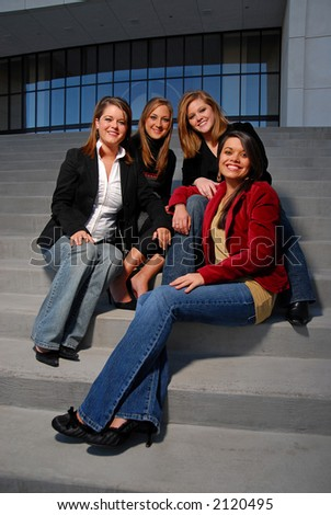 Young corporate executives on steps - stock photo