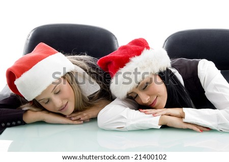 young corporate wearing christmas hat and sleeping on an isolated white background - stock photo