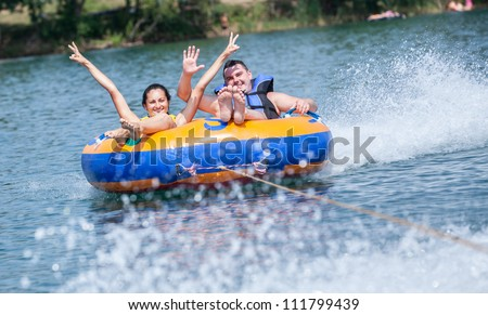 Young couiple on water attractions during summer vacations - stock photo
