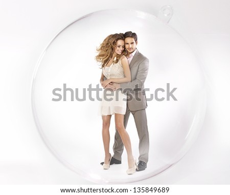 Young coupe close in glass ball - stock photo