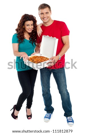 Young couple about to enjoy pizza together. Woman resting hand on her boyfriends shoulder