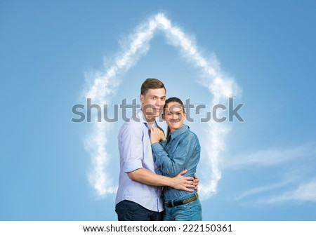 Young couple against sky background hugging each other - stock photo