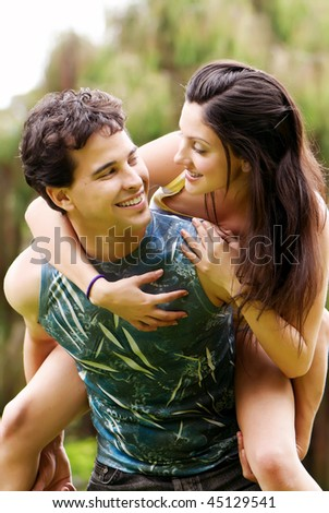 Young couple against the nature - stock photo