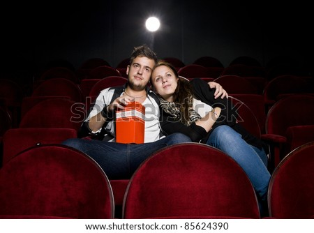 Young couple alone at the Movie Theater - stock photo