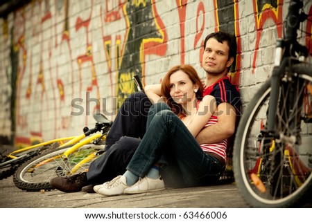 Young couple and bikes - stock photo