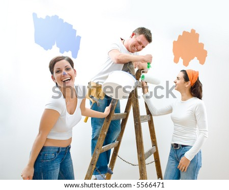 Young couple and friend improving their home. - stock photo