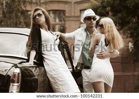 Young couple and jealous girl - stock photo