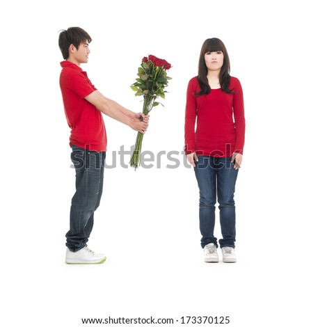 Young couple and rose. Isolated won white background. - stock photo