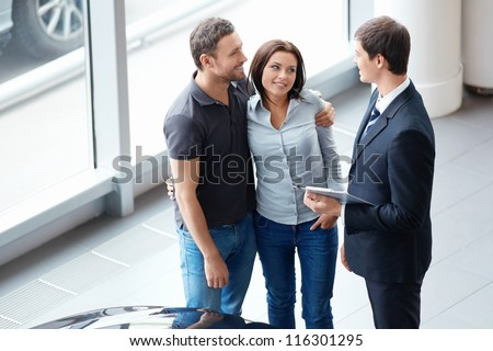 Young couple and seller - stock photo