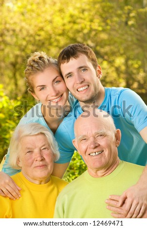 Young couple and their grandparents outdoors - stock photo