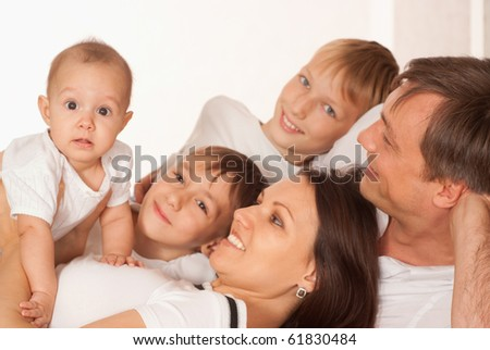 young couple and their sons on a white - stock photo