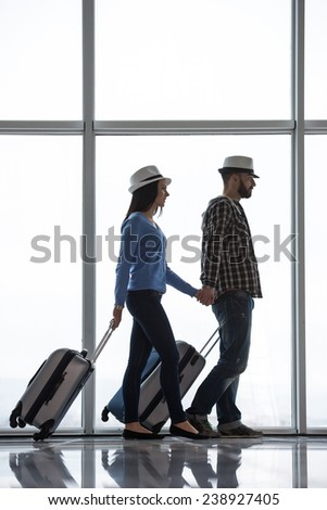 Young couple are going on a holiday by air. - stock photo