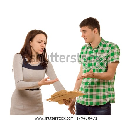 Young couple arguing over paperwork standing gesturing at a bunch of papers the angry woman is holding as the man pleads ignorance, isolated on white - stock photo