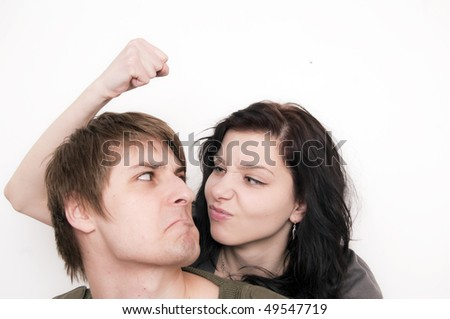 Young Couple Arguing, she menace him with the fist - stock photo
