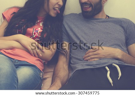 Young couple arguing with each other over white background - stock photo