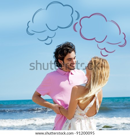 Young couple at beach, embracing, side view. Natural emotions. Happy life. Blank cloud balloons for their thoughts overhead - stock photo