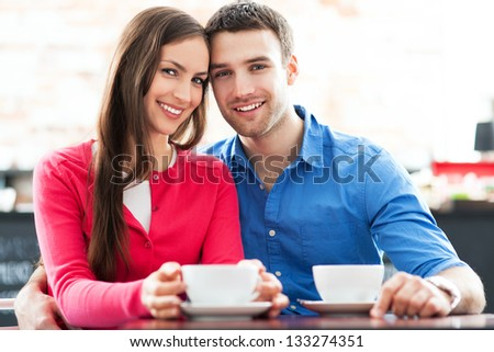 Young couple at cafe - stock photo