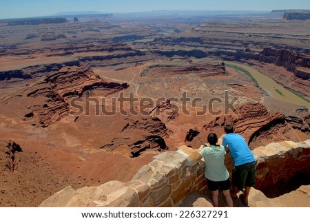 Young Couple at Dead Horse Point National Park in Utah, USA - stock photo