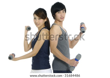 Young couple at fitness training with weights, isolated on white