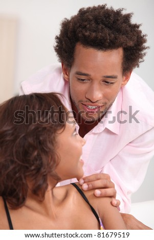 Young couple at home - stock photo