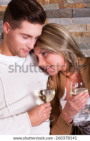 young couple at home, smiling - stock photo