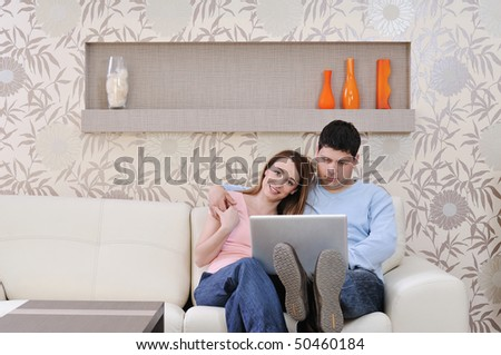 young couple at home with  modern livingroom indoor working on laptop on house finance and planing