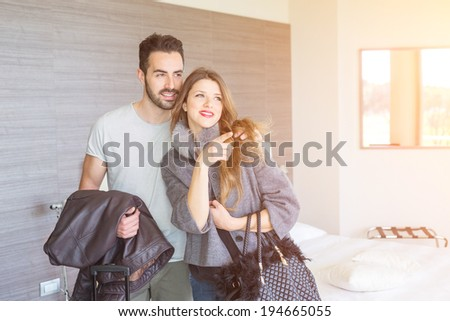 Young Couple at Hotel Room - stock photo