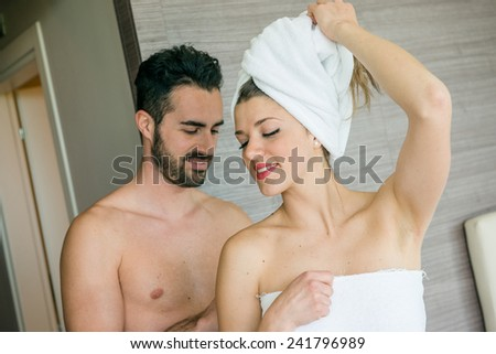 Young Couple at Hotel Room after Shower - stock photo
