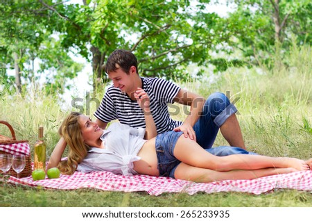 Young couple at picnic in forest - stock photo