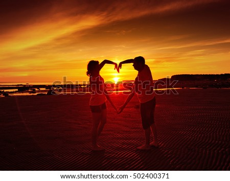 Young couple at sunset.