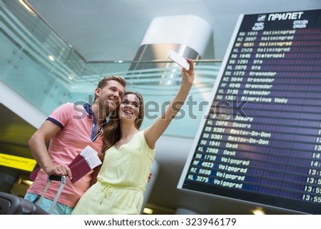 Young couple at the airport makes selfie - stock photo