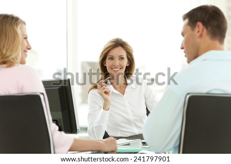 Young couple at the bank - stock photo