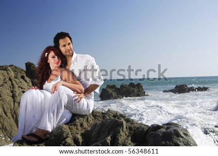 Young Couple at the Beach holding each other