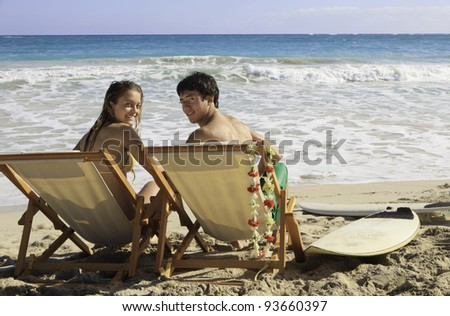 young couple at the beach in hawaii - stock photo