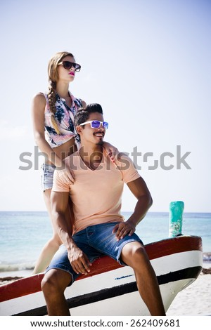Young couple at the beach with a fashion style - stock photo