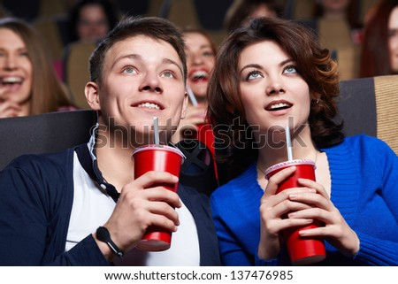 Young couple at the cinema - stock photo