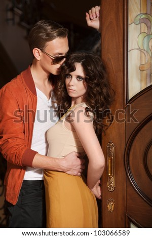 Young couple at the door - stock photo