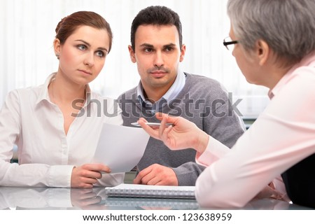young couple at the  financial planning consultation - stock photo