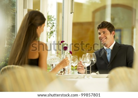 Young couple at the restaurant - stock photo