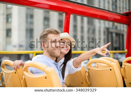 Young couple at the tour bus - stock photo