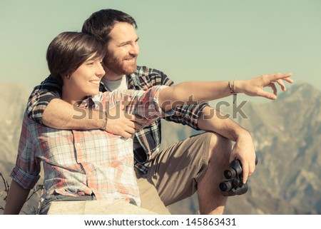 Young Couple at Top of Mountain - stock photo