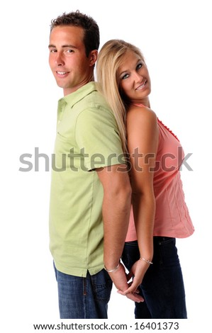 Young couple back to back holding hands isolated over a white background - stock photo