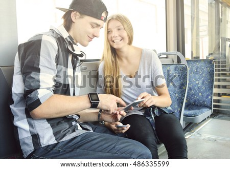 Young couple being together with phones.