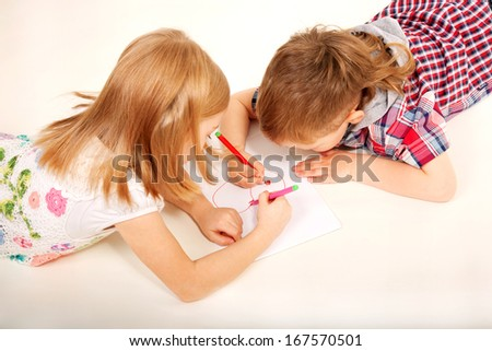 Young couple, boy and girl drawing heart. Love and valentine's day concept. - stock photo